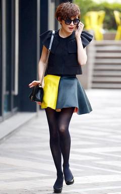 孙俪《辣妈正传》中的荷叶边套装装束,俏皮的荷叶边,短裙,撞色的设计,那抹黄色就像黑夜里的明灯,照亮了时尚!