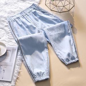 新款时尚大码女裤天丝<span class=H>牛仔裤</span>休闲运动裤200斤加肥加大透气九分裤