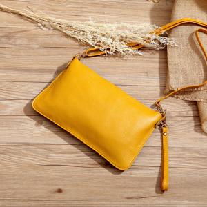 新款包郵熱銷頭層牛皮真皮時尚手拿包手包單肩斜挎迷你小包女學生