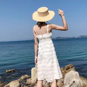 海边度假沙滩裙2018夏仙女露背毛毛<span class=H>吊带</span><span class=H>蛋糕裙</span>白色羽毛流苏连衣裙